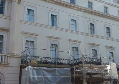 Installing foam insulation at Belgrave Square, London