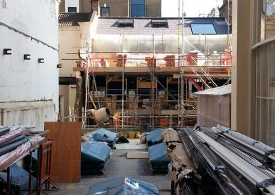Installing roof insulation at Belgrave Square, London