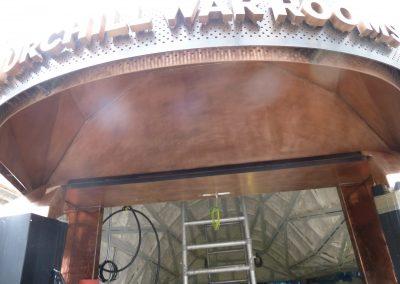 Installing sprayfoam insulation to the Churchill War Rooms Foyer