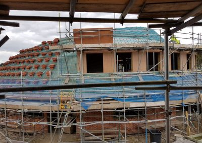 Photo showing exterior of New Build Eco-Home Ten Oaks, Bovingdon, prepared for sprayfoam insulation by Isotech