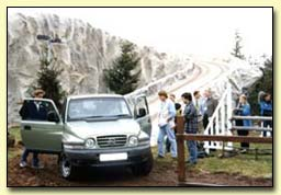 Small photo showing Jeremy Clarkson and the Top Gear team testing the sprayed foam landscape installed by Isotech at Earls Court Motor Show
