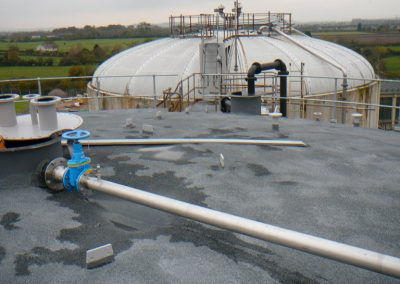 Photo showing Silicone Coating and Slate Dressing to Sprayed Insulation of Waste Water Tank by Isotech