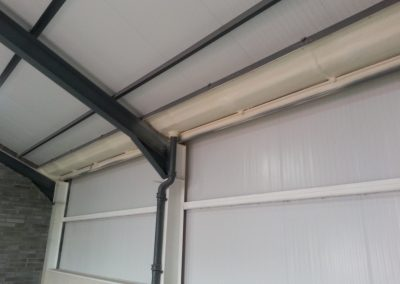 Photo showing spray foam insulation applied to guttering by Isotech