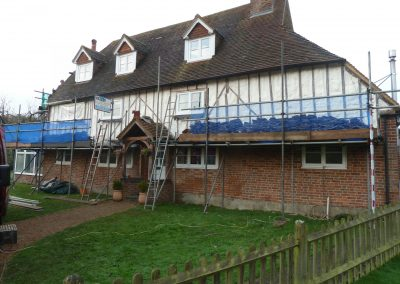 Photo showing sprayed foam insulation applied by Isotech to external tile hung elevation