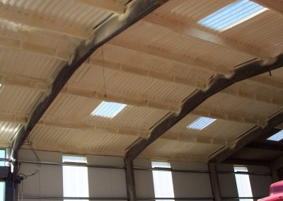 Photo of Sprayed Foam Insulation installed to barn roof cladding by Isotech