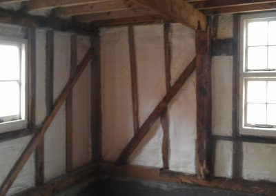 Photo of sprayfoam insulation installed to timber framed wall by Isotech