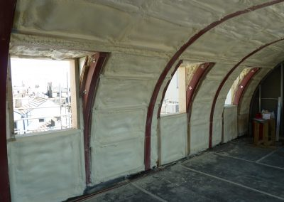 Photo showing spray foam insulation applied to roof of New Build Penthouse Apartment in Hove by Isotech