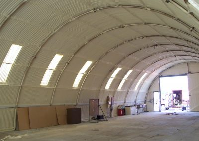 Photo of Nissen Hut at Goodwood Motor Racing Circuit showing sprayed foam insulation installed by Isotech