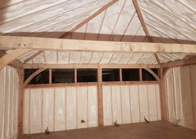 Photo of sprayfoam installed to timber frame garage by Isotech