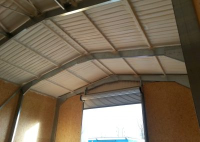 Photo showing sprayfoam insulation installed to a sports centre groundsman's workshop by Isotech