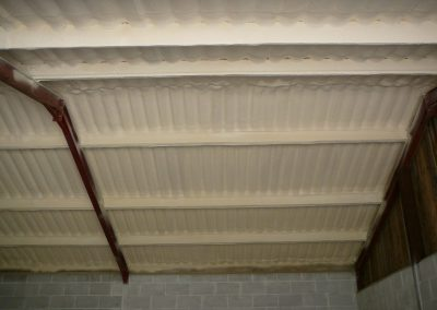 Photo showing sprayfoam insulation installed to a stable block roof by Isotech