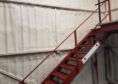 Photo showing sprayfoam insulation installed to commercial premises by Isotech