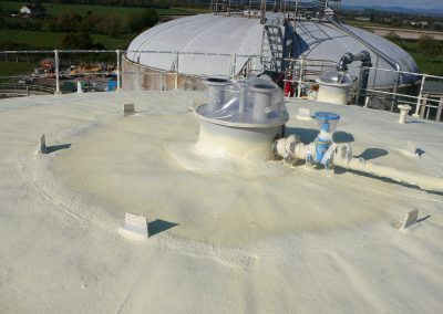 Photo showing sprayed foam insulation applied by Isotech to large waste water tank roof
