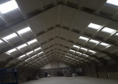 Photo showing warehouse roofing insulated by Isotech Sprayfoam