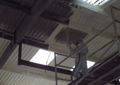 Image of Isotech Sprayfoam insulation contractors applying sprayed foam to large barn roof