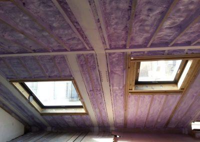 Installing foam insulation at Belgrave Square, London Mews