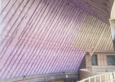 View of interior of roof space of New Build Eco Home in Bovingdon with sprayed foam insulation applied by Isotech