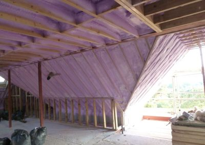 Photo of interior of roof space of New Build Passivhaus in Poole with sprayed foam insulation applied by Isotech