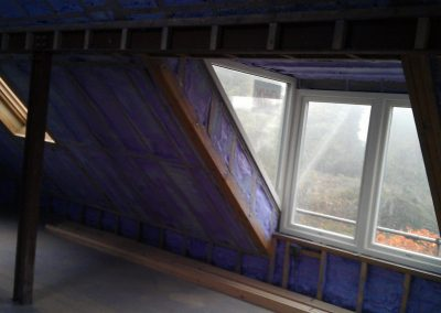 Walltite sprayed foam insulation applied to Passivhaus roof by Isotech
