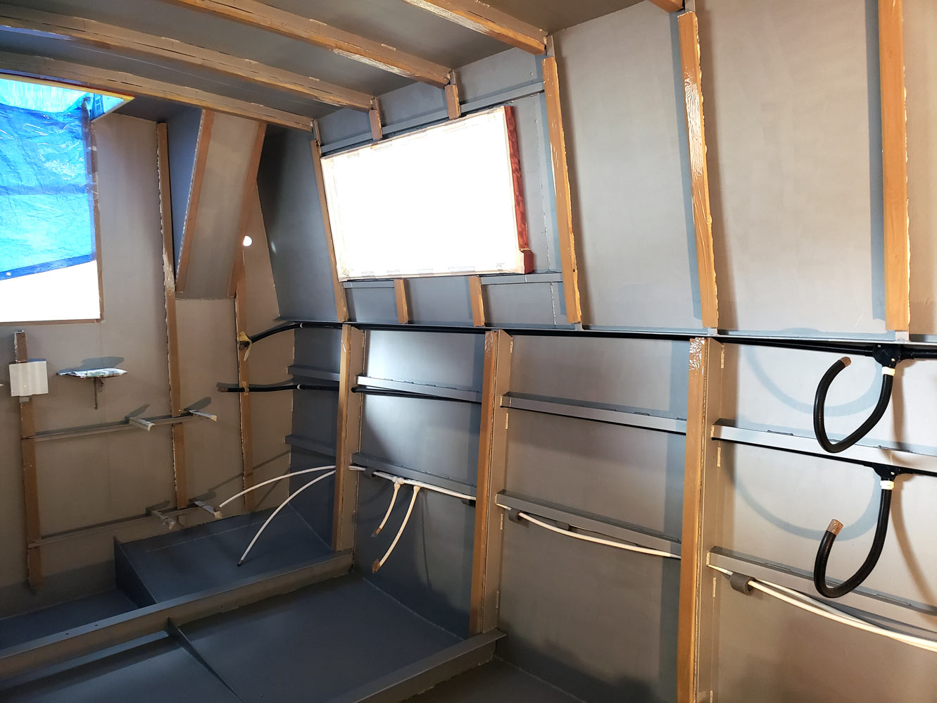 Photo of narrow boat hull interior before insulation applied